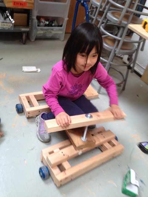 Addy tests an early iteration of her kart's steering mechanism.