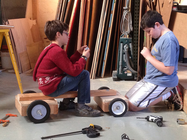Cameron and Zachary handle the eyebolts to which they'll mount their steering rope.
