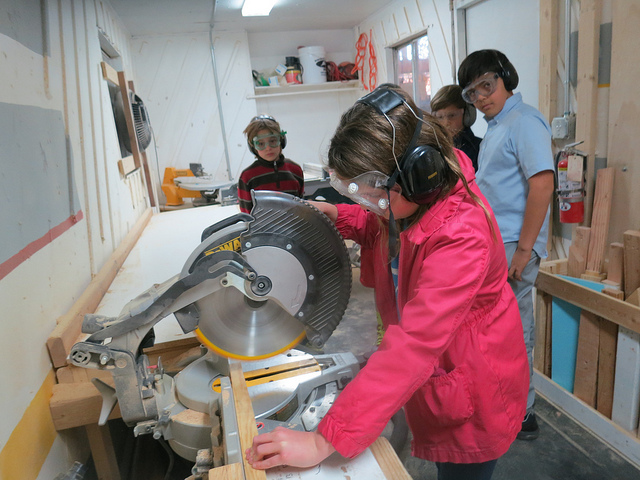 Giada passes safety training on the chop saw.