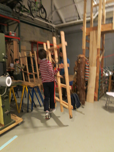 Ethan takes work in progress to the project storage area.