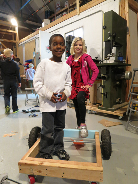 Jah-Amiel and Bella savor the installation of a well-aligned rear axle.