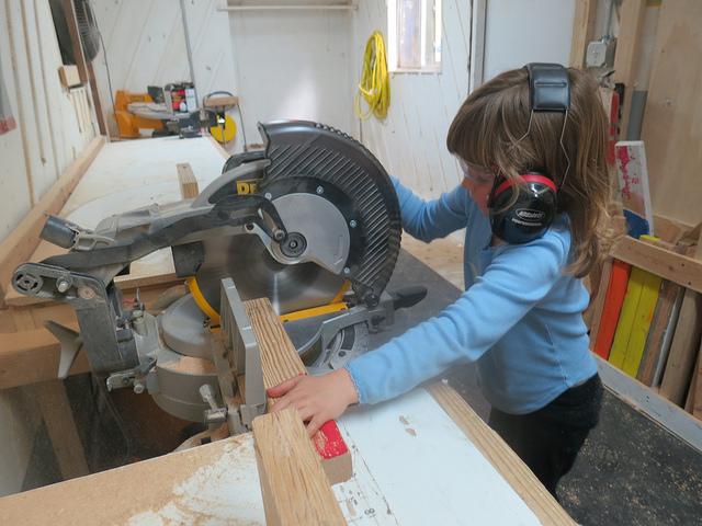 Scarlett uses the chop saw.