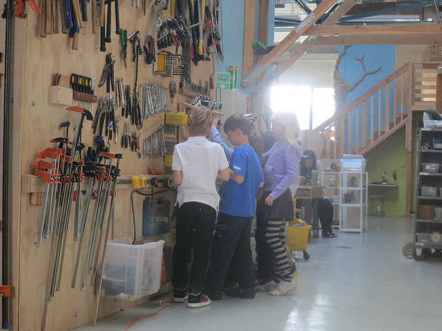 Owen, Charlotte and Zander grab drills from the tool wall.