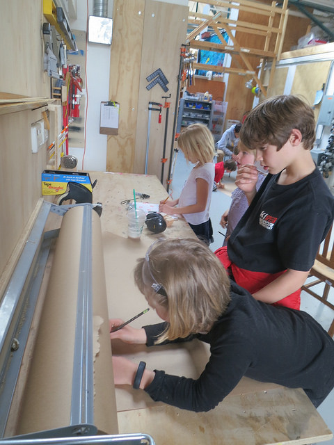Lulu and Jake start on the design of a ladder/stool.