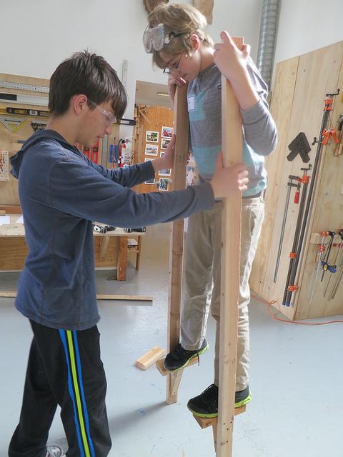 Ethan helps Dexter test a second version of their stilts.
