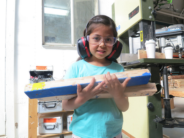 Maite, moments after learning how to use a stop to cut multiple pieces at the same length.