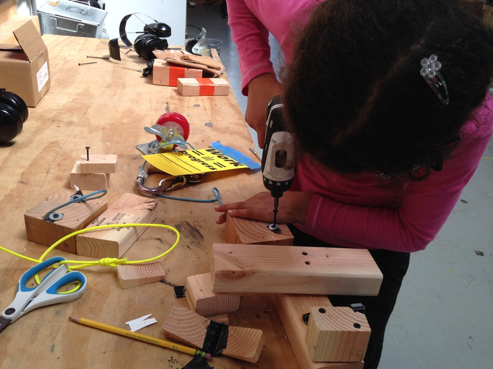 Marleah works on her small house and wooden skates.