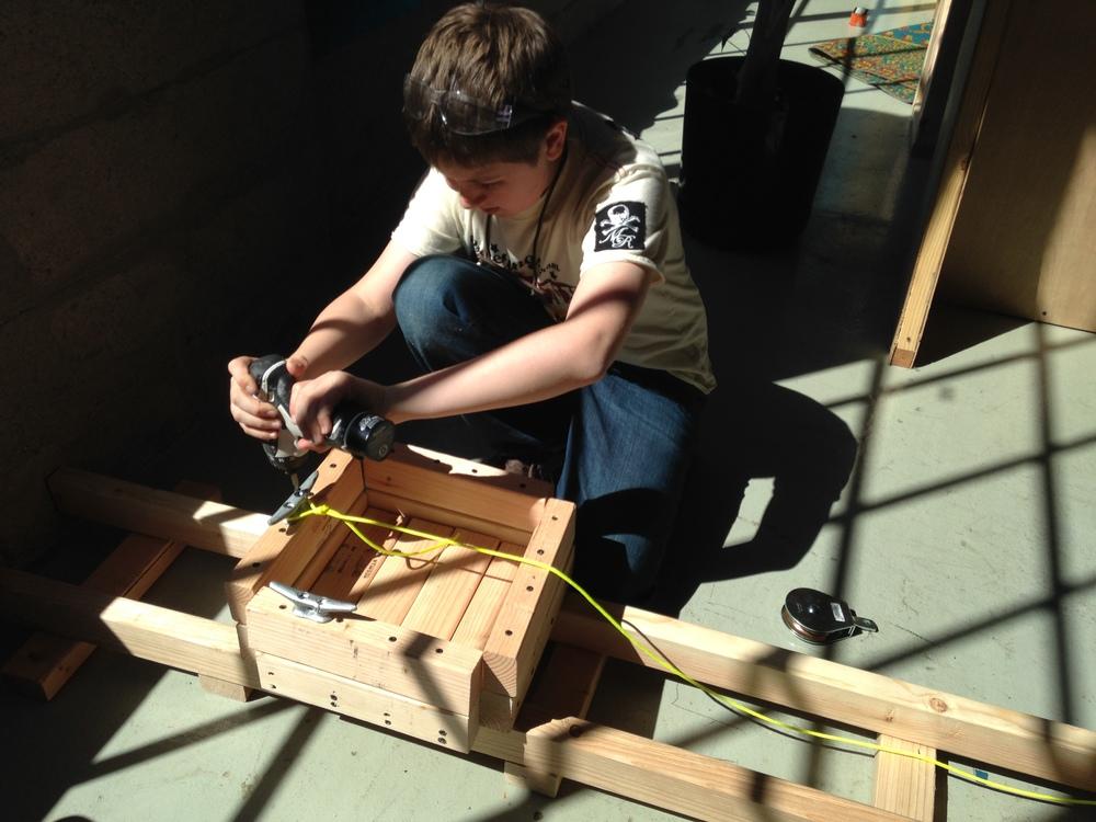 Trent assembles a lift prototype.