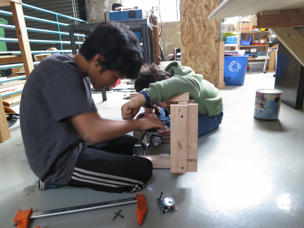 Jake and Oscar, our skunkworks team, spent diligent hours tweaking the pulleys for the lift.