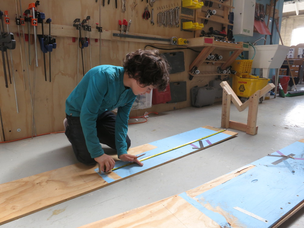 Elijah double checks the plywood that will actually hold the water.