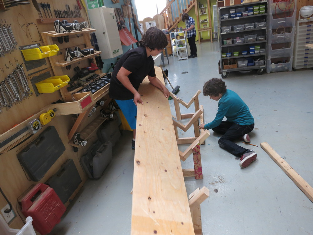 Gio and Elijah start to assemble a gutter.