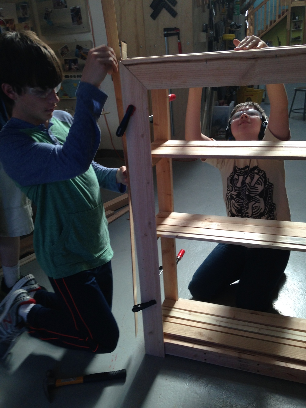 Ethan works out a miter while Trent mates the face frame to the cladding on top. Both features will be highly visible to users.