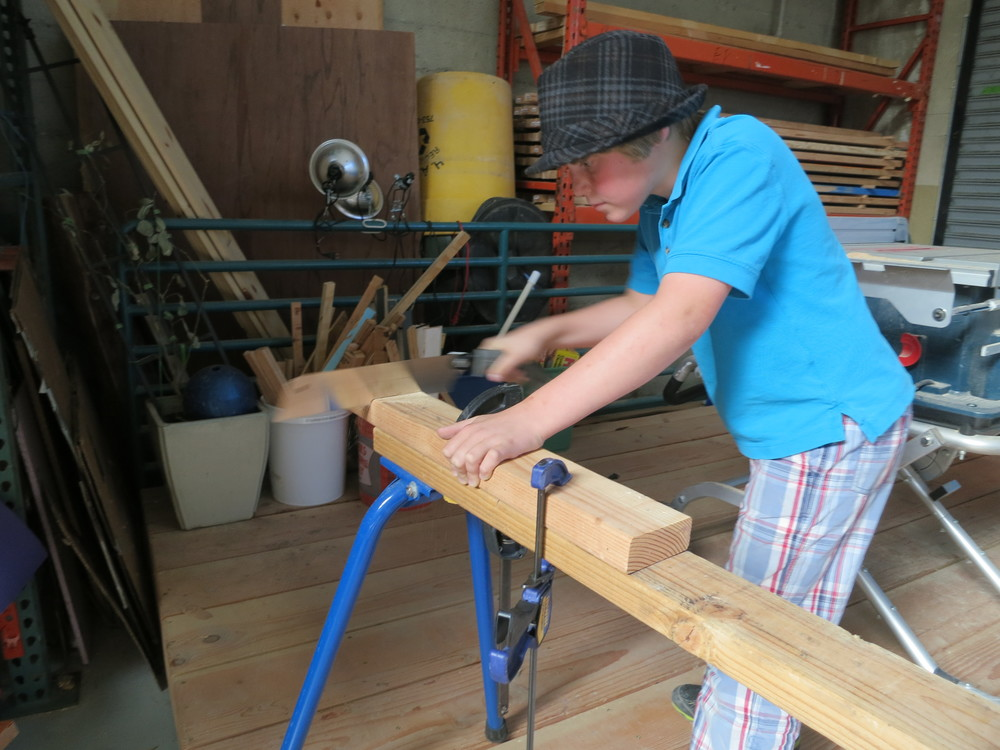 Travis practices the pullsaw.