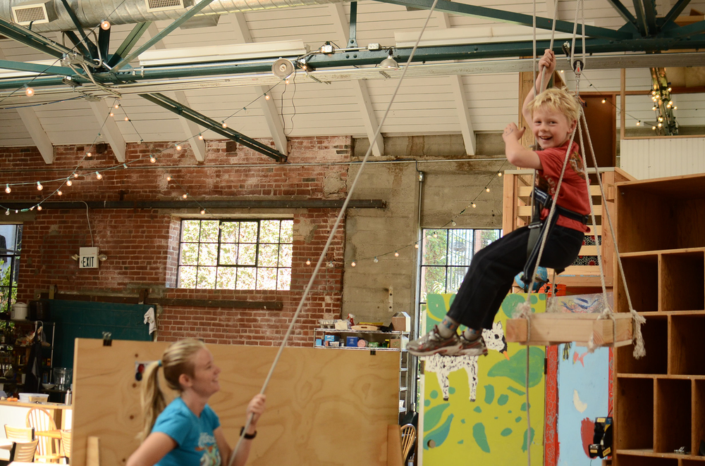 Lincoln pulls himself up to the rafters on an elevator and pulley system built during day camp. Lindsay holds the safety line. Lincoln's enthusiasm and happiness are largely attributable to Lindsay's enthusiasm and happiness. If you're stoked, the kids will be stoked.