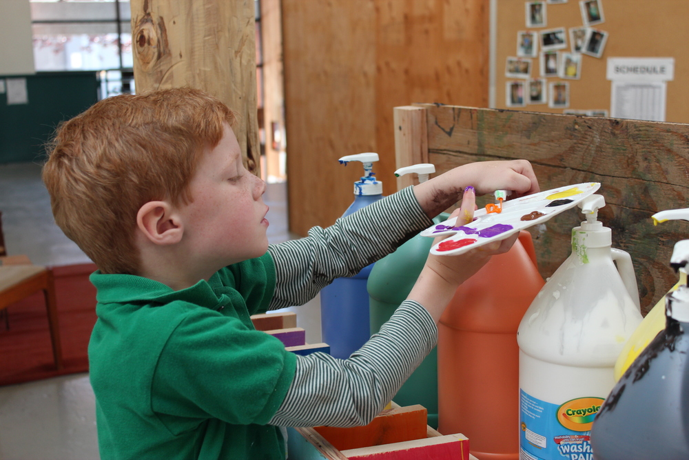 At Tinkering School, kids can just walk right up to the paint and help themselves!