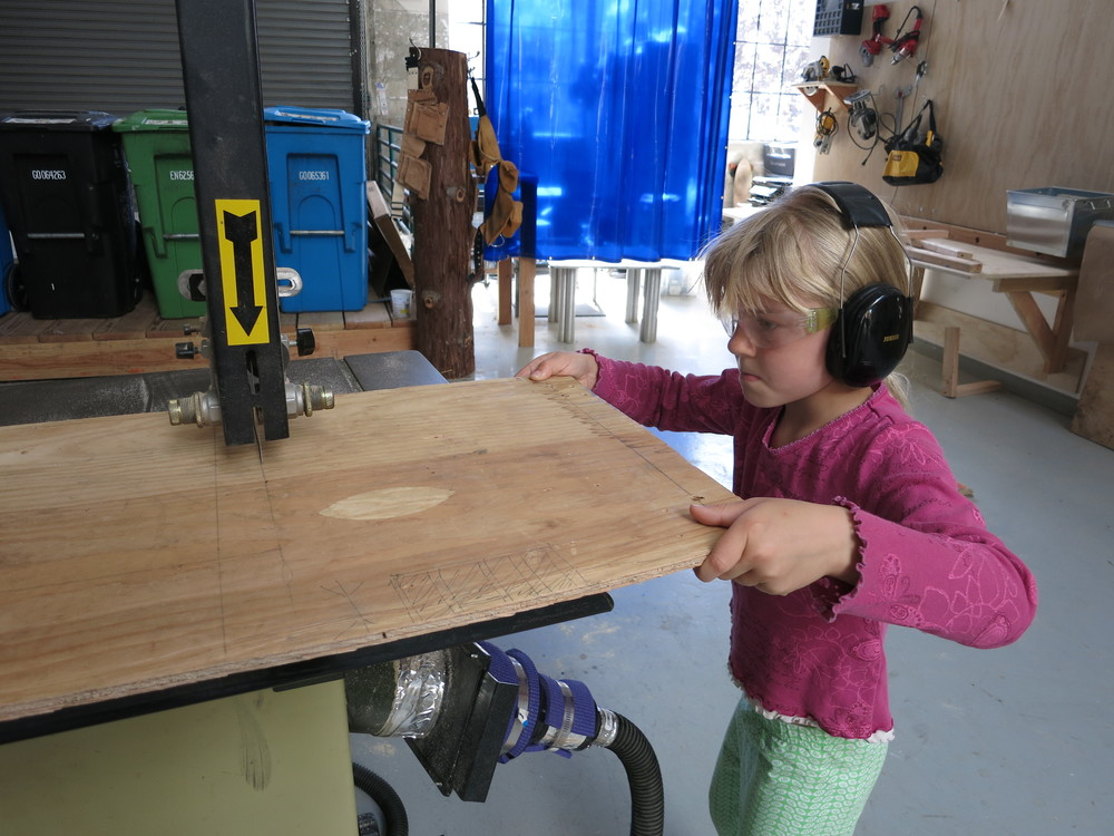 Ida on the bandsaw--such focus!