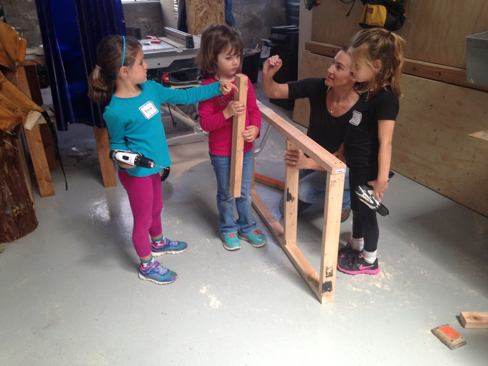 Adia, Jessica, Lulu and Diana start a frame for a cart.