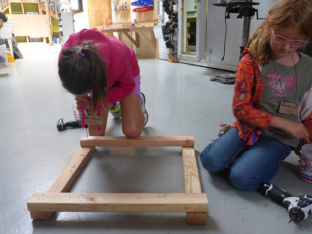Kiera and Olivia join together and figure out how to join beams at right angles to make frames!