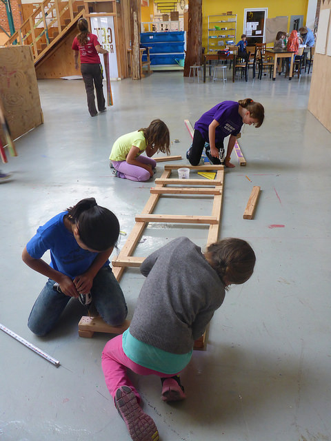 Zia, Lucy, Maddie, and Emilia assemble a tower support for The Grabber.