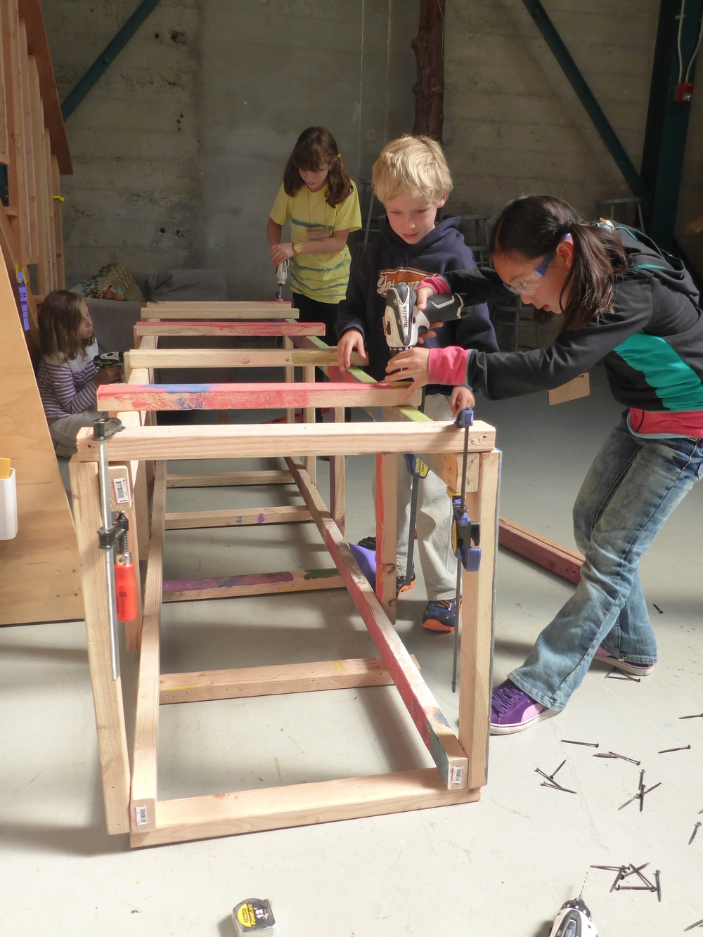 Maddie, Benjamin, Lucy and Zia build one of the four 8-foot towers for the giant claw machine.