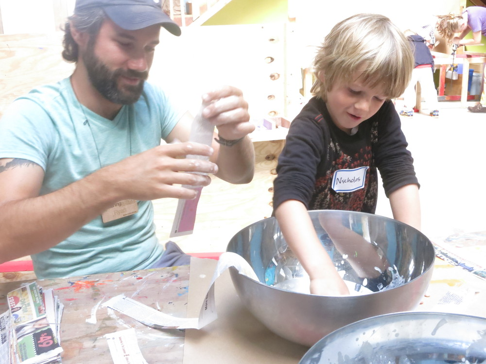 Nicholas and Ryan mix flour and water for paper mache.