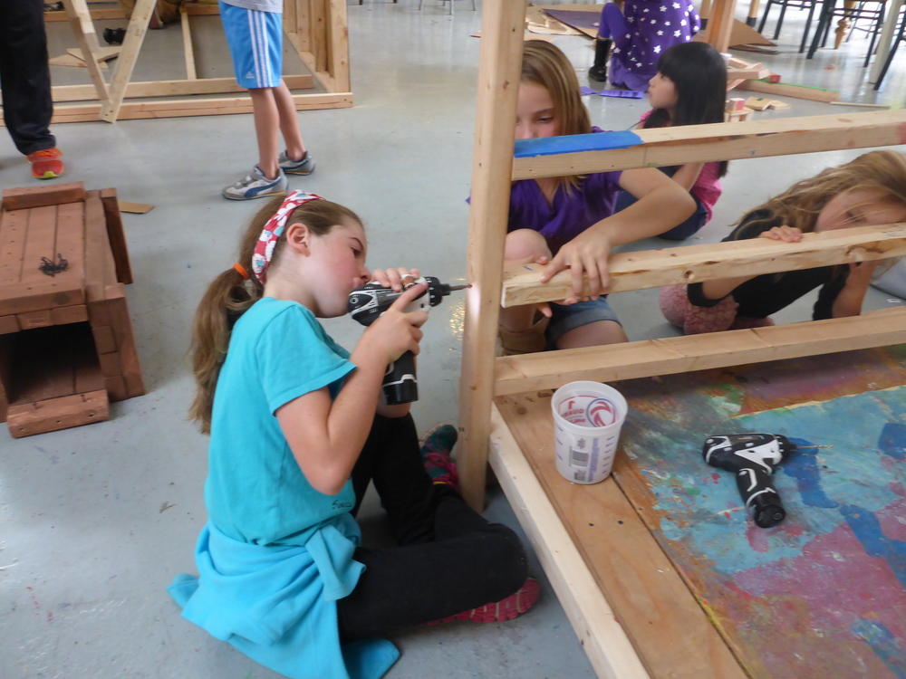Abby, Eliza and Zoey have used almost every tool in the shop constructing a deb with tall posts and a curtain.