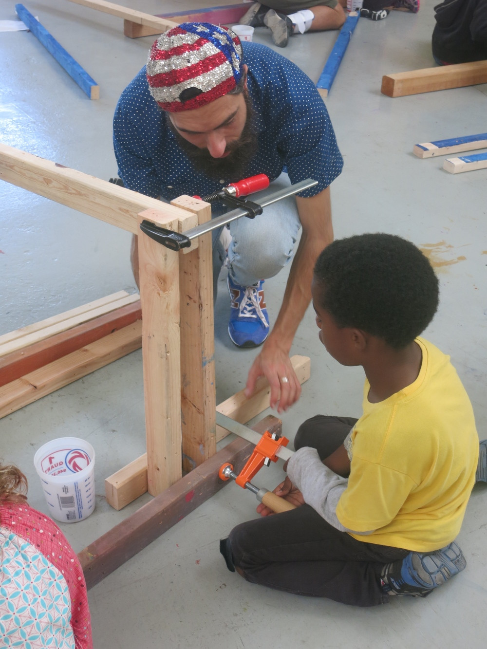 Jah-Amiel and Nathan clamp the base of a balance beam.