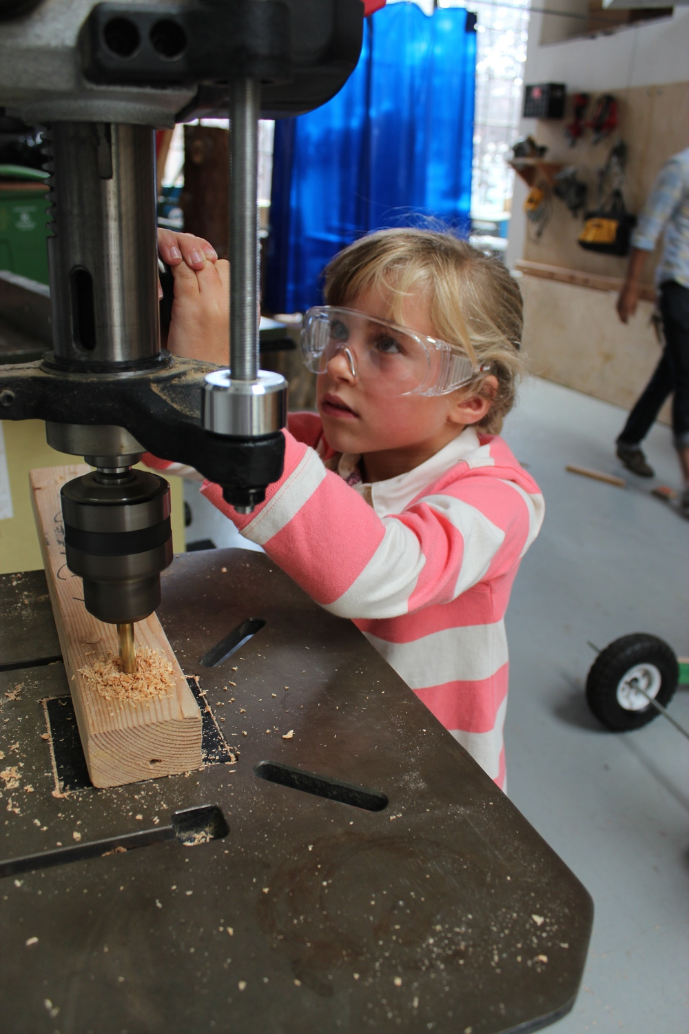 Maya uses the drill press for a mobile part.