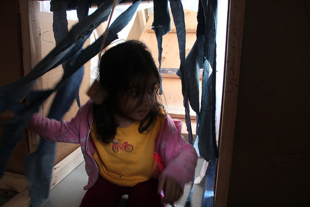 Maya makes a decision in the dark: MonkeyBars or Climbing Wall?