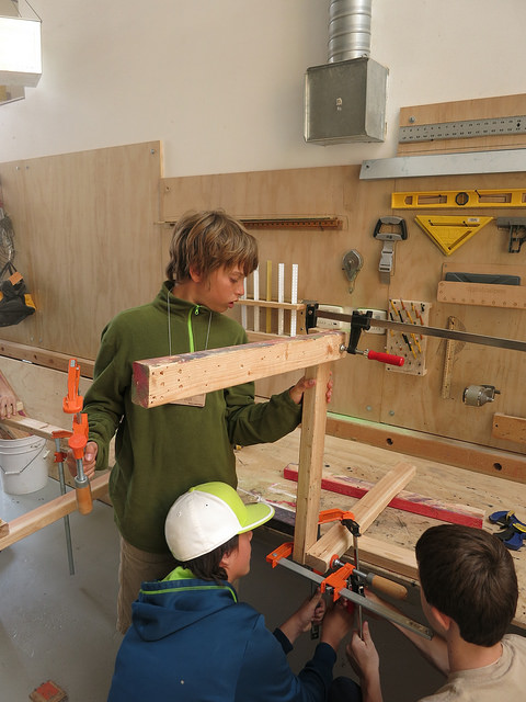 Alex, Elias, and Duncan practice intricate clamping.
