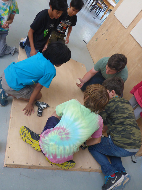 The Plinko team figures out the placement of the plinks.