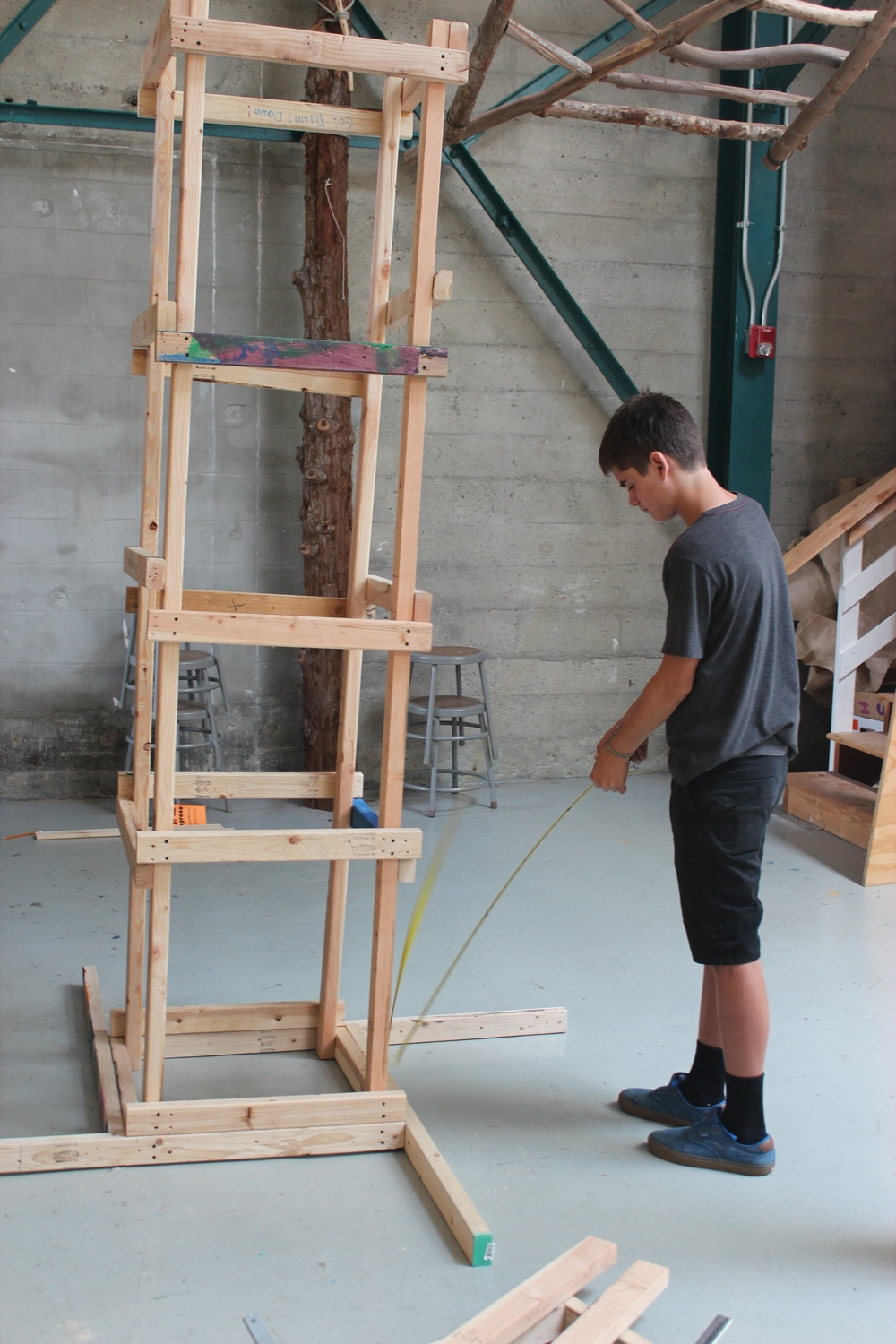 Leo measures a tower for the combustion-powered zipline.