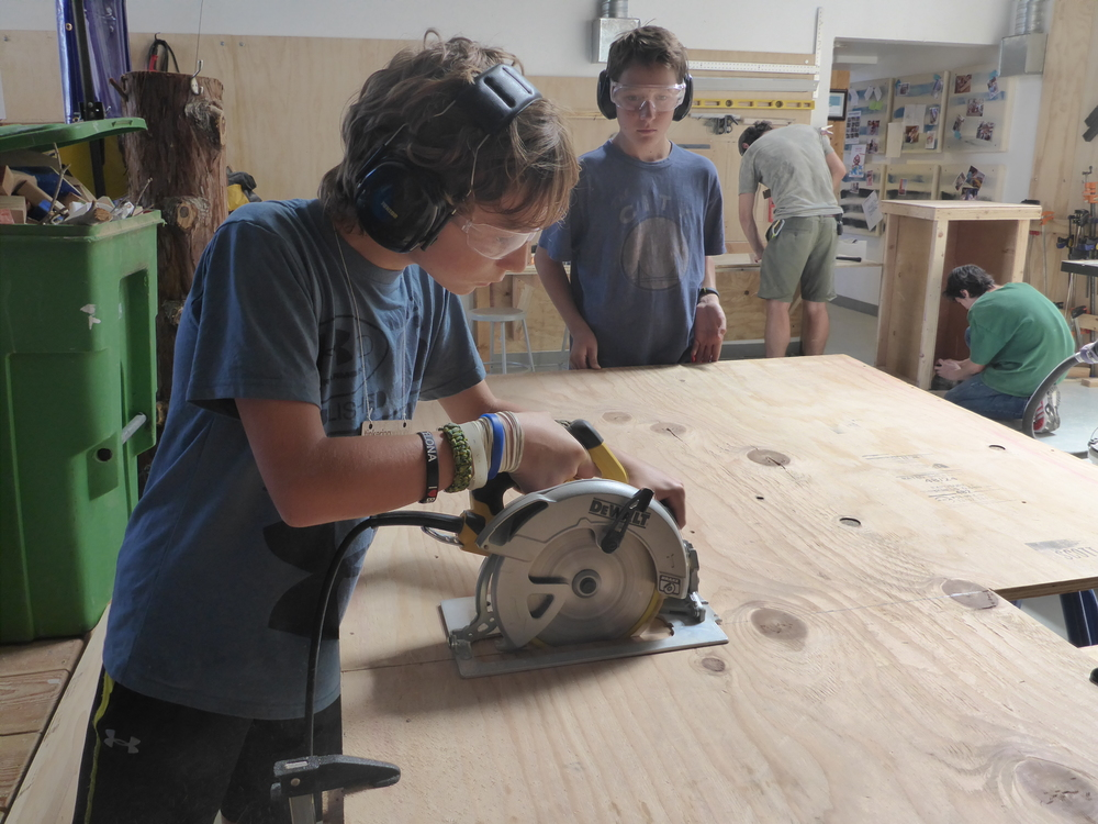 Max cutting a plate to receive the weight that will operate the chop saw.