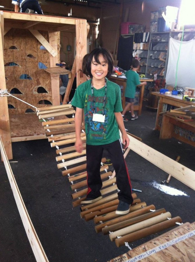 Standing on a rope bridge at Tinkering School in reDiscover Center, Los Angeles, CA.