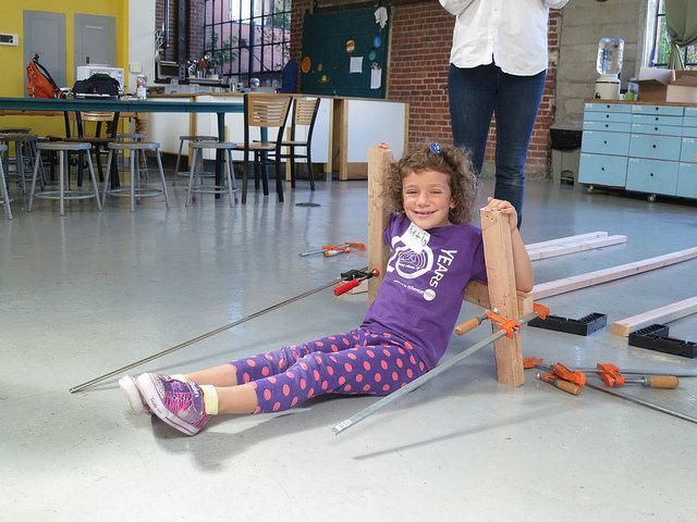 Portia models her reCLAMPer chair