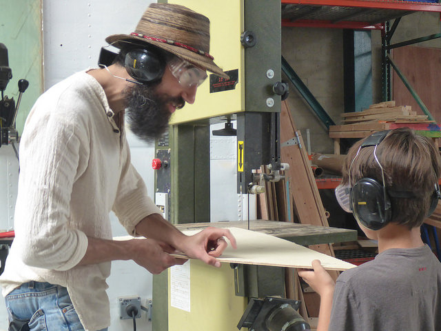 Brandin learns about how to safely operate the band saw before making his first cut