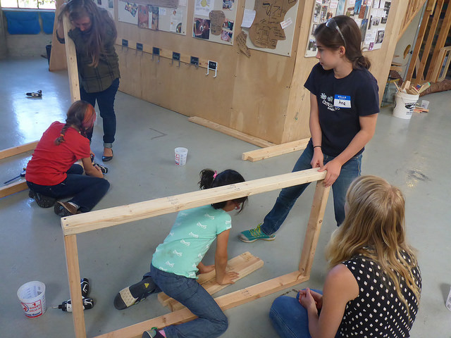 Ana and Penelope turn their frame on its side so they can get some help from gravity.