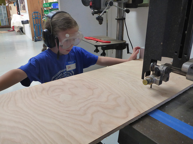 Effi uses the bandsaw to trim some plywood.