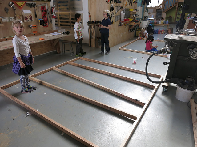 We decide to maintain the kids momentum and excitement by splitting into two groups and beginning the frame for a roof.