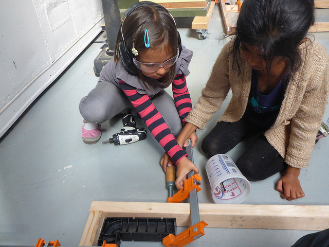 Sophie and Aanya set up some clamps for the roof's frame.