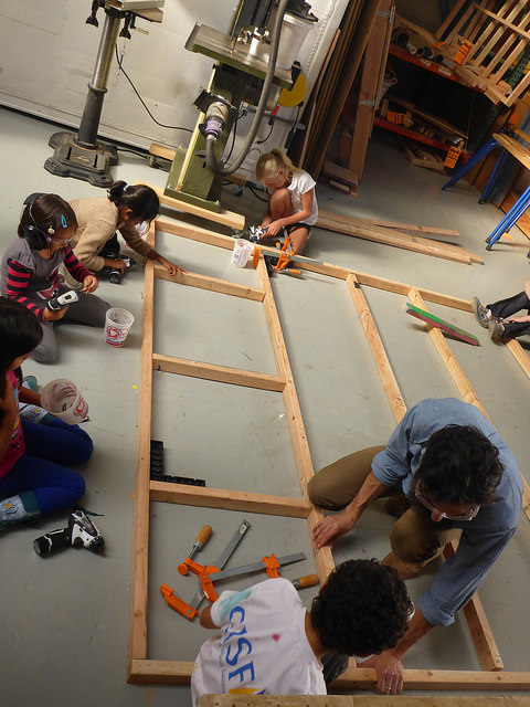 More supports mean a more sturdy floor. The team works hard on drilling in cross beams for the floor
