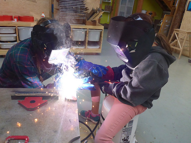 Eva and Piper team weld to get the pacing and motion of the welder just right.