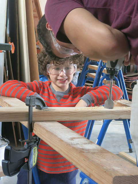 Even looking can bring about laughter. Check out Gabriel's engagement as Josh assists in drilling a large diameter hole for his trebuchet.