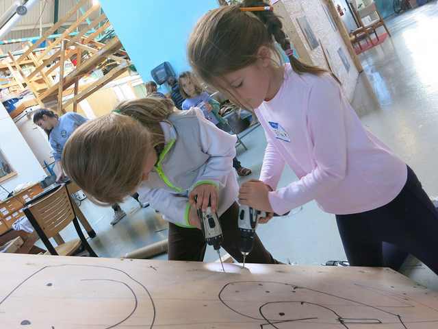 Lila and Ella drill pilot holes for the sliding surface!