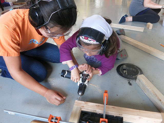 Lauren and Ananya team up to get some screws in.