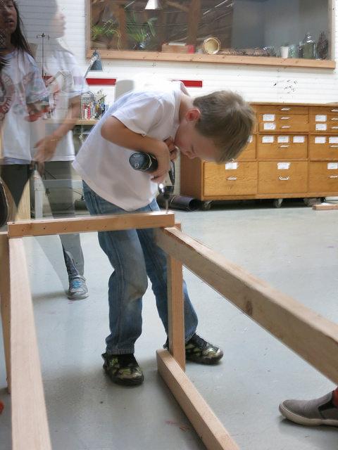 Zachary helps the Conveyor base take shape.