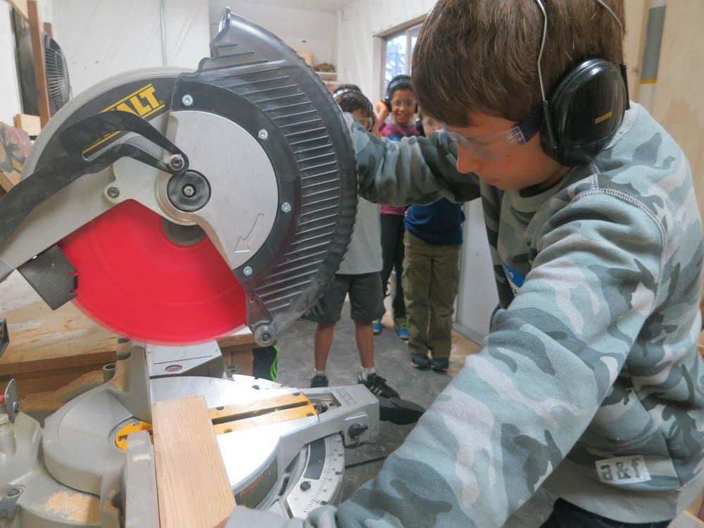 Ruben makes a cut with the chop saw