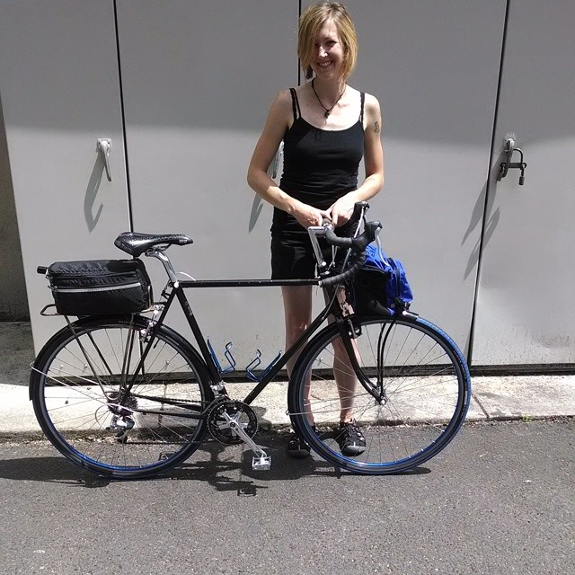 Laura with her full custom StarMichael Bowman touring bike. She brought it in after years of service to get a tune up and some changes after being fit to the bike!