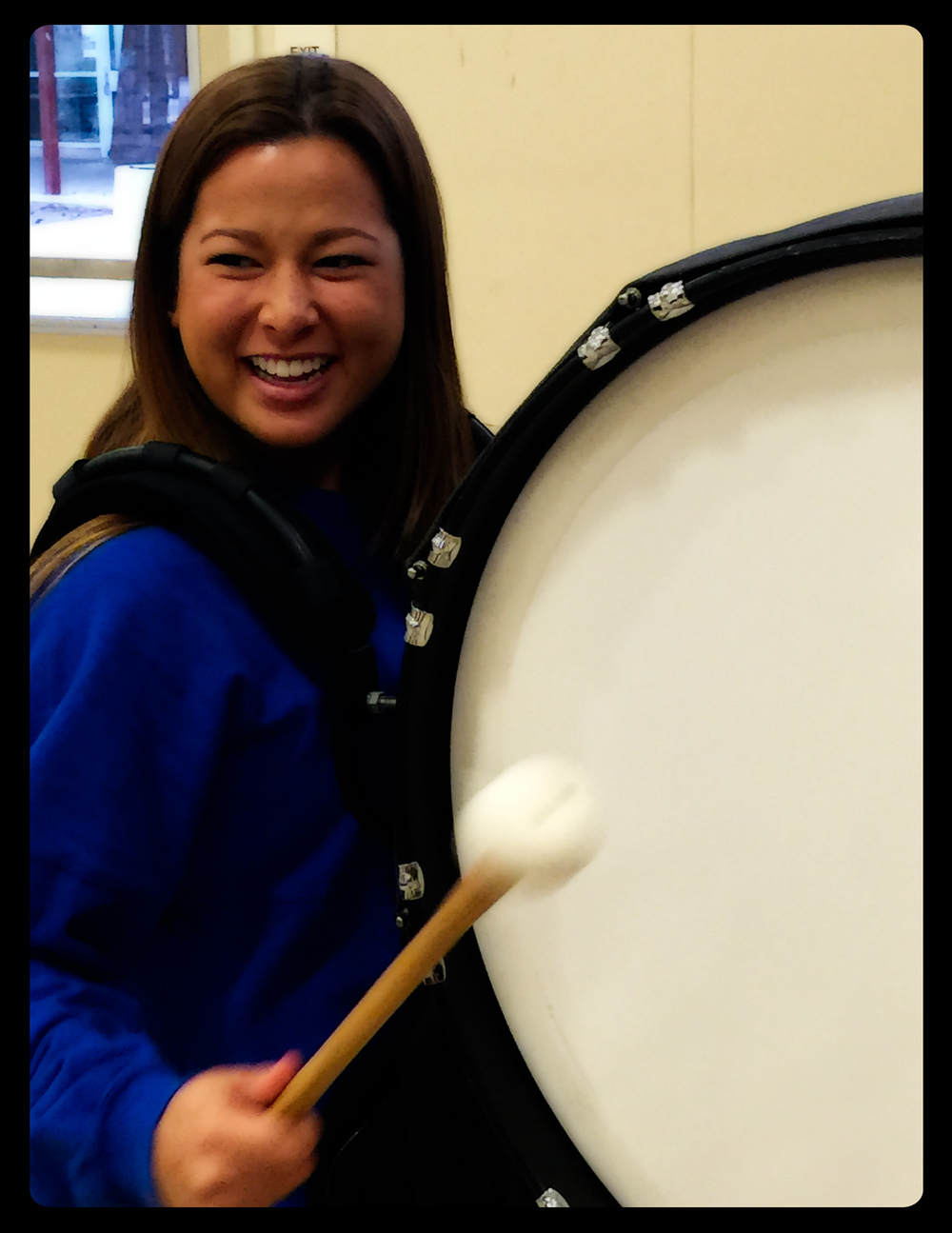 Jaclyn from Santa Clara University dons the bass drum to better understand the perspective of the TPerc performers.