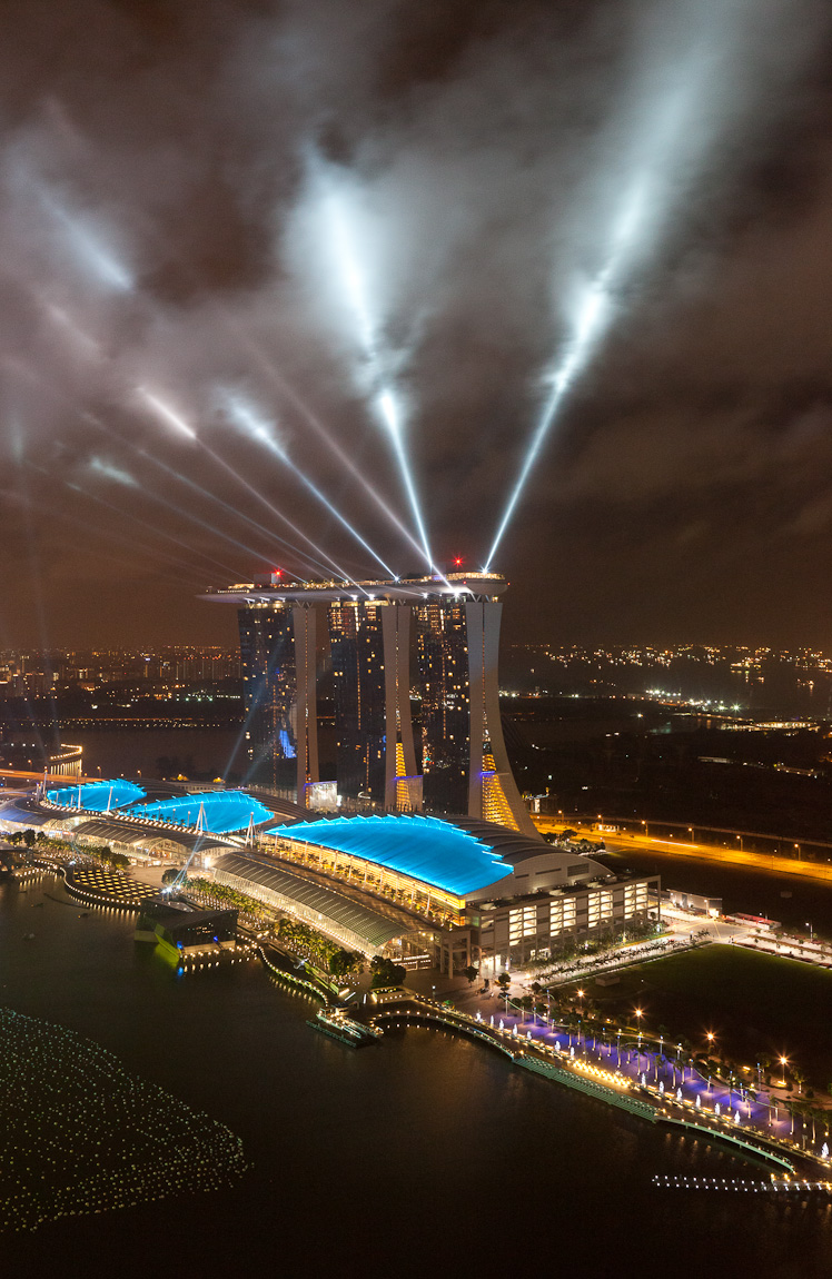 I looked out my window this morning shortly before 5 AM and saw an amazing sight--the clouds in the night sky above Marina Bay Sands were beautifully illuminated by the laser lights of the practice for Singapore Countdown 2012 (also on Google+).